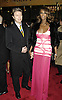"""David Bowie and wife Iman..arriving at the Broadway opening of """"The Color Purple"""" ..produced by Oprah Winfrey on December 1, 2005 ..at The Broadway Theatre...Photo by Robin Platzer, Twin Images"""