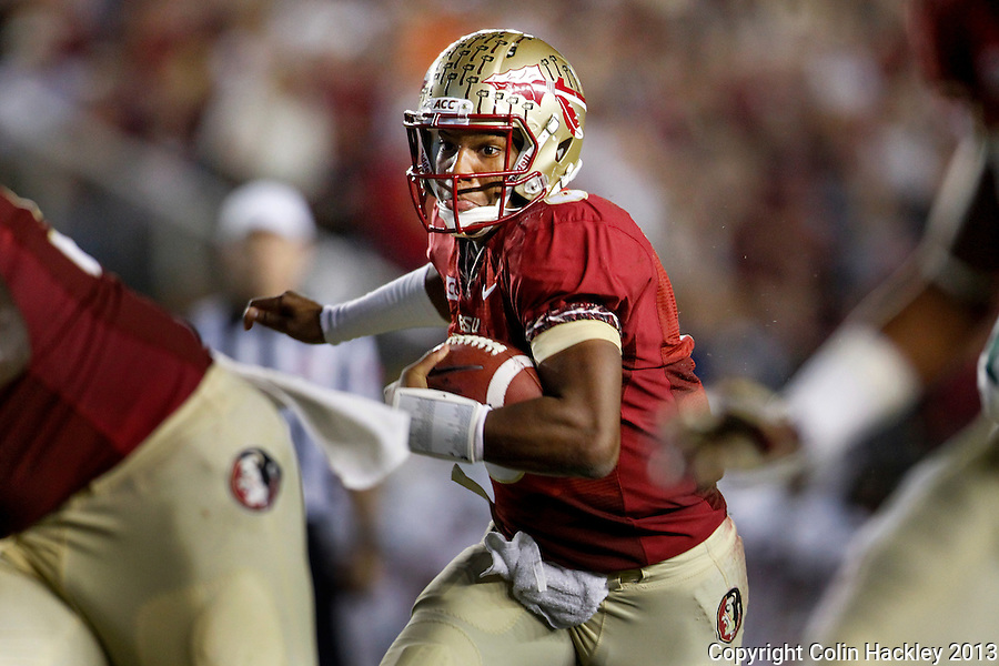 TALLAHASSEE, FL 11/2/13-FSU-MIAMI110213CH-Florida State's Jameis Winston runs through a pack of Miami defenders during first half action Saturday at Doak Campbell Stadium in Tallahassee. <br /> COLIN HACKLEY PHOTO