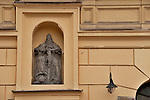 """A niche on a building with a religious sculpture in Krakow, Poland. Krakow is also known at the """"City of Churches"""" with over 120 churches and many convents and monasteries"""