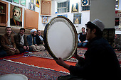 BIARA, IRAQ: A student plays traditional religious songs after Friday prayers...The Biara Madrassa--a religious school--is located high up in the mountainous Kurdish Hawraman region that makes up the Iran/Iraq border. Before 2003 the region was home to a fundamentalist Islamic group called Ansar al-Islam who used the school as a base. The Unites States military attacked the area and the madrassa numerous times during the 2003 invasion, finally pushing Ansar al-Islam out...Today the madrassa is home to 48 male students from all across Kurdish Iraq. The students leave their families and immerse themselves in their studies and the daily life of Koranic students...Photo by Besaran Tofiq