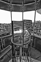 A black and white view inside the top of the 1808 Gibraltar Point Lighthouse at the Toronto Islands.