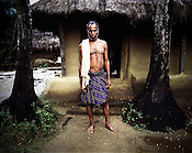 Bansidhar Bhola poses outside his hut in Dinghia village in Orissa, India. His hut is the closest to the entry gate of the village. Temporary fences have been erected by them around the boundary of the village to prevent the entry of survey team into their area. South Korean steel giant POSCO continues to face stiff public resistance in Orissa's Jagatsinghpur district where the company is setting up India's biggest direct foreign investment project of 12 million tonne steel plant. These villagers have formed an agitating group, &quot;Posco Pratirdh Sangram Samiti&quot; to oppose the construction of Posco port in their village.