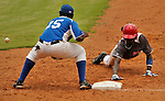 """Major League Baseball prospect Bladimil Matos slides in safely during the five inning at the final game of the """"Torneo Supremo"""" at the Quiskeya National Stadium in Santo Domingo. The Tournament which aims to maximize the ability of Major League Baseball organizations to scout in the Dominican Republic. According to the MLB's office in the Dominican Republic, this year, the tournament introduced 23 new baseball prospects. July 29 2011. ViewPress/ Kena Betancur"""