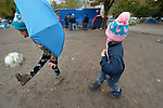 Seven-year old Farah kicks a ball in a city park in Belgrade, Serbia, as her four-year old brother Mashad follows. They are refugees from Syria, and with their family fled that nation for western Europe. This park has filled with refugees from several countries stopping over on their way to Germany, Sweden, Holland, and elsewhere. <br /> <br /> Parental consent obtained.