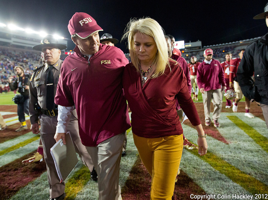 TALLAHASSEE, FL 11/24/12-FSU-UF112412 CH-Florida State Head Coach Jimbo Fisher consoles his wife Candi after Florida beat the Seminoles 37-26 Saturday at Doak Campbell Stadium in Tallahassee. .COLIN HACKLEY PHOTO