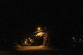 Snowy night on a dark city street
