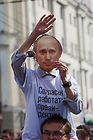 Moscow, Russia, 06/05/2012..A woman in a Puin mask at opposition demonstration against Russian Presidential election results on the eve of Vladimir Putins inauguration as President.