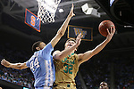 14 March 2015: Notre Dame's Steve Vasturia (32) and North Carolina's Justin Jackson (44). The Notre Dame Fighting Irish played the University of North Carolina Tar Heels in an NCAA Division I Men's basketball game at the Greensboro Coliseum in Greensboro, North Carolina in the ACC Men's Basketball Tournament quarterfinal game. Notre Dame won the game 90-82.