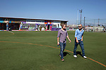 Khayelitsha, South Africa March 5, 2013: Amandla EduFootball founders  <br /> Jakob Schlichtig and Florian Zech walk on the field in Khayelitsha a poor township outside Cape Town, South Africa. They use football to initiate, support educational projects for youth in the township. The program keep children busy and it decreases the risk of them joining gang, criminal activity or teenage pregnancy. The crime level has decreased substantially in the area since the program was created in 2006. (Photo by: Per-Anders Pettersson )