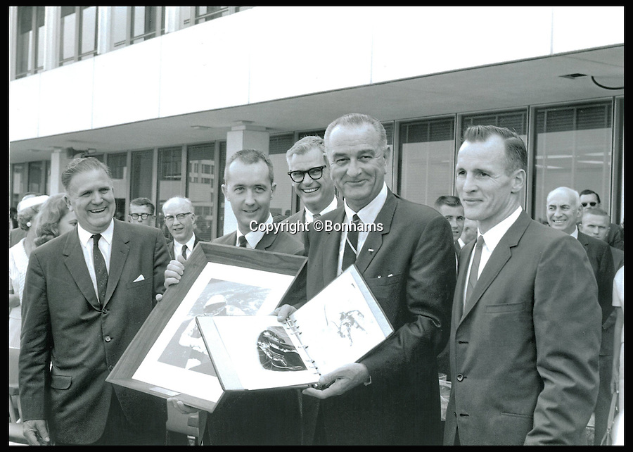 BNPS.co.uk (01202 558833)<br /> Pic: Bonhams/BNPS<br /> <br /> *Please use full byline*<br /> <br /> Edward White meeting with US President Lyndon B Johnson at the Space Center in Houston.<br /> <br /> A bloodstained document revealing a life-or-death episode that could have jettisoned the whole US space programme of the 1960s is tipped to sell for an astronomical &pound;80,000.<br /> <br /> The complete 13 page checklist was for the very first spacewalk undertaken by man in 1965 and documents a dramatic incident in which the astronauts struggled to close the hatch of their spacecraft afterwards.<br /> <br /> It is being sold by Bonhams in New York later this month.