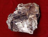 VESUVIANITE (IDOCRASE)<br /> A calcium, iron, magnesium silicate<br />  Brown idocrase contains some beryllium oxide (BeO). Tetragonal-Ditetragonal Bipyramidal