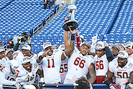 Annapolis, MD - December 3, 2016: Temple Owls players hold the AAC trophy after the game between Temple and Navy at  Navy-Marine Corps Memorial Stadium in Annapolis, MD.   (Photo by Elliott Brown/Media Images International)
