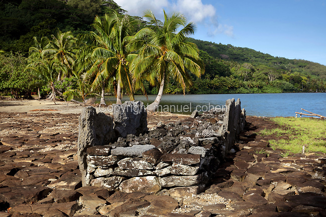 Marae Fare Roi, a stone courtyard with platform and standing stones, built by a Polynesian civilisation and used as a ceremonial and religious site, on the banks of Lake Fauna Nui or Maeva Lake, at the archaeological site at Maeva village, on Huahine-Nui on the island of Huahine, in the Leeward Islands, part of the Society Islands, in French Polynesia. This marae is a Tupuna marae or family shrine of the chiefdom or mata'eina'a, and is thought to have housed a representation of a god. The marae are thought to date from 13th - 15th centuries. Maeva is thought to be an abandoned royal settlement, with many megalithic structures including marae, houses, agricultural structures, stone fish traps and fortification walls. Picture by Manuel Cohen