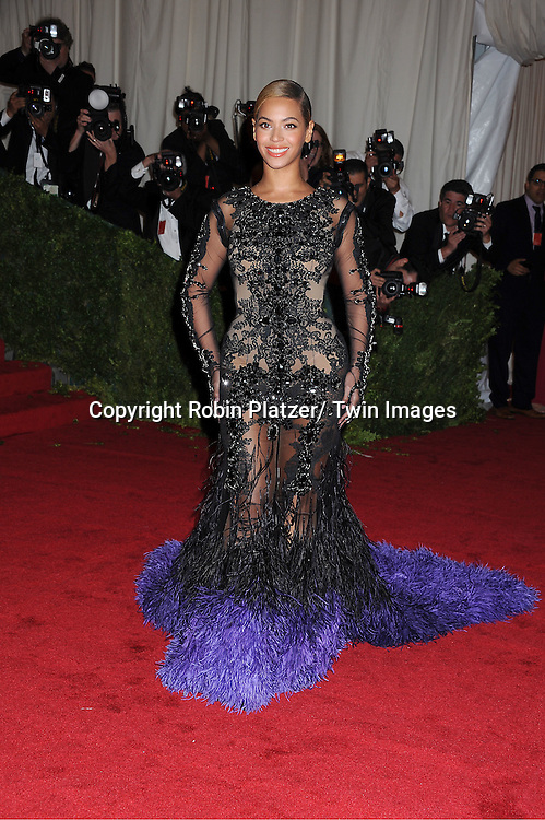 Beyonce in Givenchy attends the Costume Institute Gala Benefit celebrating &quot;Schiaparelli and Prada: Impossible Conversations&quot;.an exhibition at the Metropolitan Museum of Art in New York City on May 7, 2012.