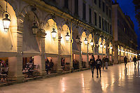 People strolling along the arcades of the Liston at night at the Spianada in Kerkyra, Corfu Town, Greece