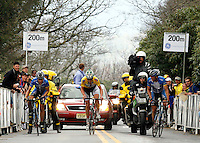 (Left to right) Tom Danielson, of the Discovery Channel Pro Cycling Team, Floyd Landis, of Phonak Hearing Systems, and Yaroslav Popovych, of the Discovery Channel Pro Cycling Team, climb a 24-percent-grade section of Brasstown Bald in Towns County, Ga. during Stage 5 of the Ford Tour de Georgia on Saturday, April 22, 2006. Danielson won the 94.5-mile (152.1-km) stage from Blairsville to the top of Brasstown Bald, the highest point in the state. Landis finished second and retained the yellow leader's jersey, while Popovych finished third.<br />