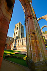 Gothic arch & bell tower of Fountains Abbey , founded in 1132, is one of the largest and best preserved ruined Cistercian monasteries in England. The ruined monastery is a focal point of England's most important 18th century Water, the Studley Royal Water Garden which is a UNESCO World Heritage Site. Near Ripon, North Yorkshire, England