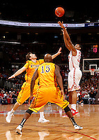 Ohio State Buckeyes guard Lenzelle Smith Jr. (32) takes a three pointer over Wyoming Cowboys guard Jerron Granberry (15) and guard Riley Grabau (2) during the first half of the NCAA basketball game at Value City Arena in Columbus on Nov. 25, 2013. (Adam Cairns / The Columbus Dispatch)