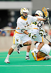 10 April 2011: University of Vermont Catamount midfielder Kyle Sminkey, a Senior from White River Junction, VT, in action against the University at Albany Great Danes on Moulton Winder Field in Burlington, Vermont. The Catamounts defeated the visiting Danes 11-6 in America East play. Mandatory Credit: Ed Wolfstein Photo