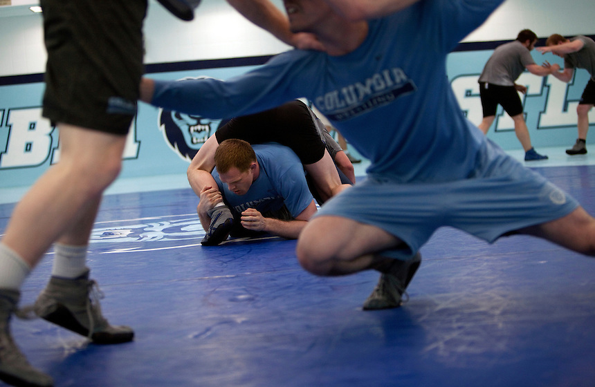 Assistant wrestling coach of the Columbia University's wrestling team, Hudson Taylor, center, live wrestling with Josh Houldsworth at Columbia University in Manhattan, NY on May 20, 2013. Taylor has been one of very few athletes who have supported the LGBT community, even though he himself is straight.