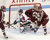 Blake Bolden (BC - 10), Tori Hickel (NU - 55), Corinne Boyles (BC - 29),Alex Carpenter (BC - 5) - The Northeastern University Huskies defeated Boston College Eagles 4-3 to repeat as Beanpot champions on Tuesday, February 12, 2013, at Matthews Arena in Boston, Massachusetts.