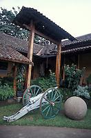 Canon and pre-Columbian stone sphere in the Museo Nacional de Costa Rica, San Jose, Costa Rica