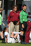 04 November 2009: Florida State's Tori Huster (in white, below) receives treatment in front of head coach Mark Krikorian after suffering a game-ending injury. The Florida State University Seminoles defeated the Duke University Blue Devils 2-0 at Koka Booth Stadium in WakeMed Soccer Park in Cary, North Carolina in an Atlantic Coast Conference Women's Soccer Tournament Quarterfinal game.
