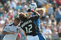 Los Angeles Galaxy goalkeeper Josh Saunders (12) and Los Angeles Galaxy defender Sean Franklin (5) protect the goal against San Jose Earthquakes forward Steven Lenhart (24). The San Jose Earthquakes tied the Los Angeles Galaxy 0-0 at Buck Shaw Stadium in Santa Clara, California on June 25th, 2011.