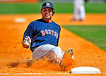 14 March 2009: Boston Red Sox' outfielder Jeff Bailey slides safely into third base with a triple during a Spring Training game against the Baltimore Orioles at Fort Lauderdale Stadium in Fort Lauderdale, Florida. The Orioles defeated the Red Sox 9-8 in the Grapefruit League matchup. Mandatory Photo Credit: Ed Wolfstein Photo