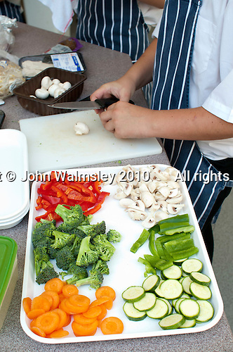 Preparing the ingredients for a stir fry, state secondary school.