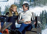 Actor George Hamilton with unidentified woman at Gretl's restaurant, Aspen mountain, Aspen Colorado, December, 1978. Photo by John G. Zimmerman