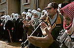 """A Druze man makes a speech at the """"Shouting Hill"""", a hill from which Druze 'shout' to their relatives who live across the border in Syria, in the Druze village of Majdal Shams, Golan Heights, in the year 2000."""