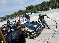#10 Corvette DP of Ricky Taylor and Jordan Taylor, pit stop, IMSA Tudor Series Race, Road America, Elkhart Lake, WI, August 2014.  (Photo by Brian Cleary/ www.bcpix.com )