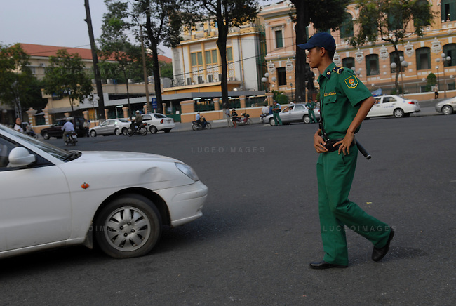 A Vietnamese police officer inspects a vehicle accident in Ho Chi Minh City, Vietnam.