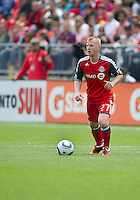 Toronto FC defender Richard Eckersley #27 in action during an MLS game between the Philadelphia Union and the Toronto FC at BMO Field in Toronto on May 28, 2011..The Philadelphia Union won 6-2..