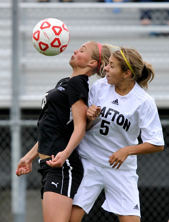 Cedarburg's Lydia Koenig (left) and Grafton's Gabi Kuester battle for the ball during the WIAA soccer sectional final at Brookfield East High School on Saturday, June 11, 2011. Grafton won the game on an autogoal in the second overtime. Ernie Mastroianni photo.