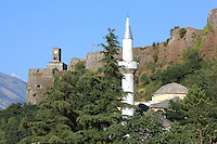 Octagonal madrasa built in 1727 originally the Bektashi Teqe, and the minaret of the Mosque, part of Memi Pasha's original 17th century plan for the Bazaar, destroyed by fire and rebuilt c. 1757, Gjirokastra, Southern Albania. Above is the Kalaja e Gjirokastres or Gjirokastra Castle. Gjirokastra was settled by the Greek Chaonians, the Romans and Byzantines before becoming an Ottoman city in 1417. Its old town was listed as a UNESCO World Heritage Site in 2005. Picture by Manuel Cohen