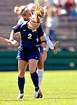 2 September 2007: University of New Hampshire Wildcats' Julie O'Shaughnessy, a Junior from Manchester, NH, collides with an opponent during game action against the University of Central Arkansas Sugar Bears at Historic Centennial Field in Burlington, Vermont. Julie was shaken up on the play but sustained no serious injury. The Wilcats shut out the Sugar Bears 3-0 during the TD Banknorth Soccer Classic...Mandatory Photo Credit: Ed Wolfstein Photo