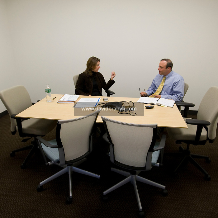Leigh Walton (L) and Russel Hochman hold a meeting at the Pitney Bowes world headquarters in Stamford, CT, United States, 7 October 2008.