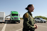 Nogales, Arizona – U.S. Customs Border Protection (CBP) Public Affairs Officer Crystal Amarillas talks to journalists in an area next to a Border Patrol checkpoint on Interstate 19, in Nogales, Arizona. National and international reporters participated in a two-day event organized by the Border Patrol. Border Patrol checkpoints serve as inspection stations to detect illegal immigration and drug smuggling. Border Patrol agents assigned to fixed traffic checkpoints have wide discretion to stop vehicles for brief questioning and inspection of its occupants and its contents. This checkpoint is part of the Border Patrol Tucson Sector. Agent Photo by Eduardo © 2012