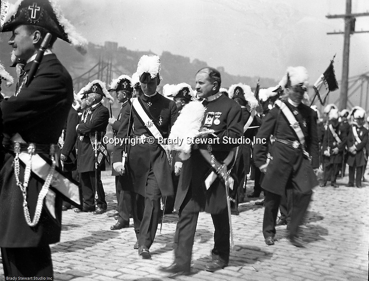 Pittsburgh PA:  Pittsburgh-area Manson marching in the annual St Patrick's Day Parade - 1903.  View of Homer Stewart and fellow Masons disbanding after the parade was finished on Water Street.