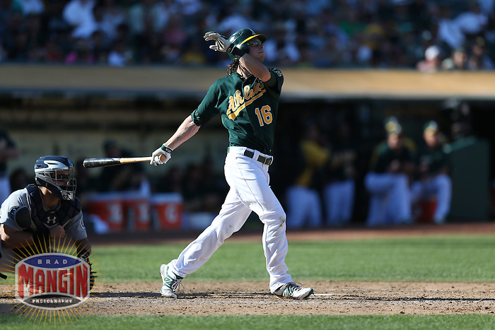 OAKLAND, CA - SEPTEMBER 30:  Josh Reddick #16 of the Oakland Athletics hits a two-run home run in the bottom of the 8th inning against the Seattle Mariners during the game at O.co Coliseum on Sunday, September 30, 2012 in Oakland, California. Photo by Brad Mangin