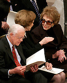 Former first lady Nancy Reagan, right, shares some thoughts with former first lady Roslyn Carter, center, as former United States President Jimmy Carter, left, looks over the program prior to the State Funeral for former United States President Gerald R. Ford at the Washington National Cathedral, in Washington, D.C. on Tuesday, January 2, 2007..Credit: Ron Sachs / CNP.[NOTE: No New York Metro or other Newspapers within a 75 mile radius of New York City].