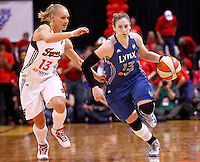 INDIANAPOLIS, IN - OCTOBER 21: Erin Phillips #13 of the Indiana Fever defends as Lindsay Whalen #13 of the Minnesota Lynx brings the ball down court during Game Four of the 2012 WNBA Finals on October 21, 2012 at Bankers Life Fieldhouse in Indianapolis, Indiana. NOTE TO USER: User expressly acknowledges and agrees that, by downloading and or using this Photograph, user is consenting to the terms and conditions of the Getty Images License Agreement. (Photo by Michael Hickey/Getty Images) *** Local Caption *** Erin Phillips; Lindsay Whalen