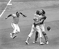Oakland Athletics third baseman Sal Bando ready to jump on closer Rollie Fingers and catcher Dave Duncan after the A's just defeated the Cincinnati Reds in the 1972 World Series. (photo by Ron Riesterer)