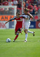17 September 2011: Toronto FC midfielder Eric Avila #8 and Colorado Rapids midfielder Brian Mullan #11 in action during an MLS game between the Colorado Rapids and the Toronto FC at BMO Field in Toronto, Ontario Canada..Toronto FC won 2-1.