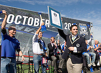 An official Guinness World Record adjudicator holds up the award in front of the audience during Groundbreaking Ceremony at new stadium in Santa Clara, California on October 21st, 2012.  San Jose Earthquakes broke Guinness World Record for 6,256 people break ground on Quakes' new stadium.