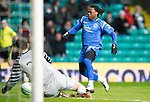 Celtic v St Johnstone....26.12.10  .Fraser Forster saves at the feet of Collin Samuel.Picture by Graeme Hart..Copyright Perthshire Picture Agency.Tel: 01738 623350  Mobile: 07990 594431