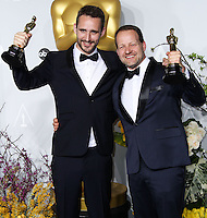 HOLLYWOOD, LOS ANGELES, CA, USA - MARCH 02: Anders Walter, Kim Magnusson at the 86th Annual Academy Awards - Press Room held at Dolby Theatre on March 2, 2014 in Hollywood, Los Angeles, California, United States. (Photo by Xavier Collin/Celebrity Monitor)