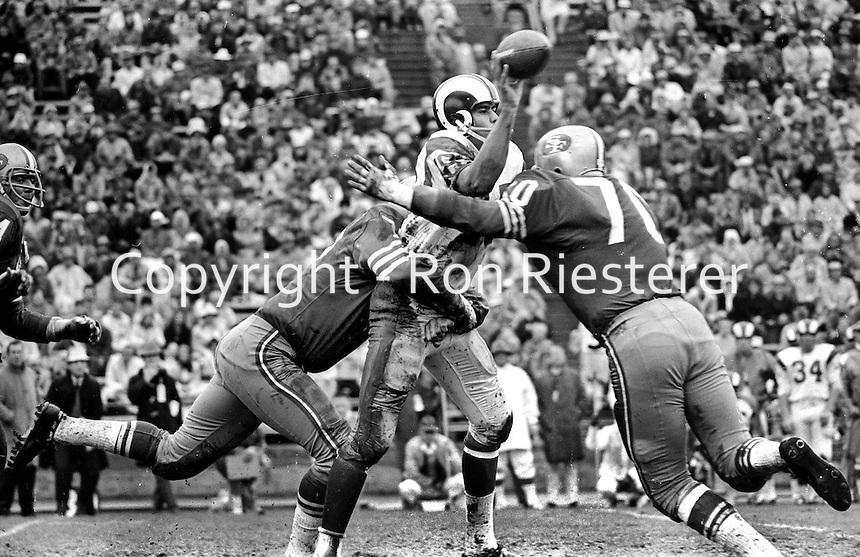 San Francisco 49ers hit Los Angeles quarterback Roman Gabriel, #70 Charlie Krueger.(1966 photo by Ron Riesterer)